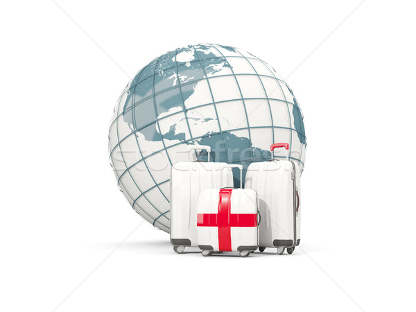 Luggage with flag of england. Three bags in front of globe Stock photo © MikhailMishchenko