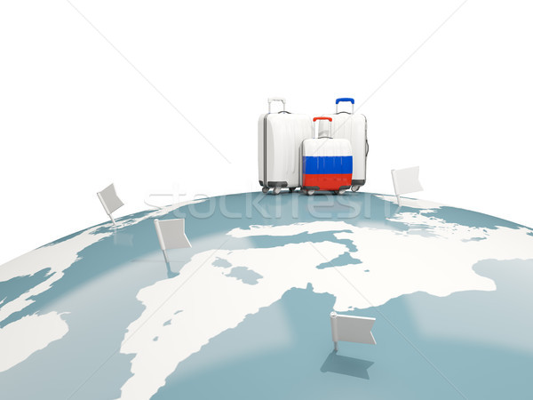Stock photo: Luggage with flag of russia. Three bags on top of globe