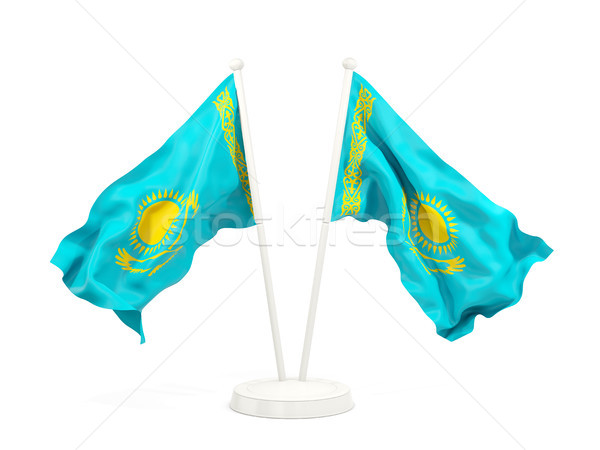 Dois bandeiras Cazaquistão isolado branco Foto stock © MikhailMishchenko