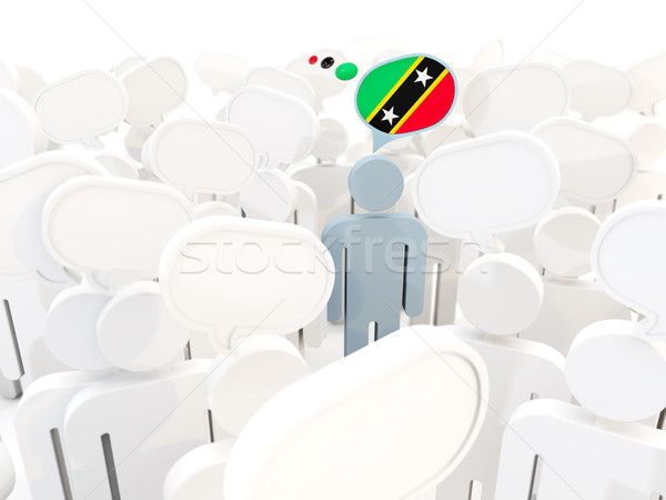 Man with flag of saint kitts and nevis in a crowd Stock photo © MikhailMishchenko
