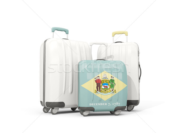 Luggage with flag of delaware. Three bags with united states loc Stock photo © MikhailMishchenko