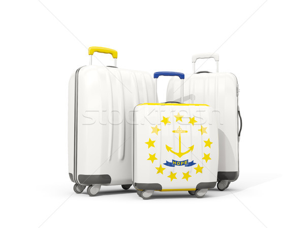 Luggage with flag of rhode island. Three bags with united states Stock photo © MikhailMishchenko