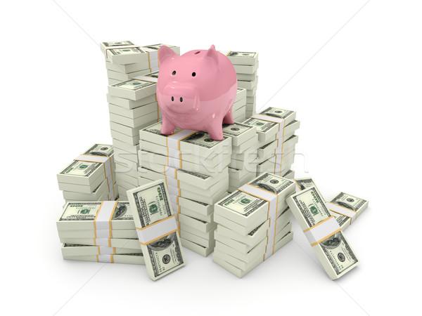 Piggy bank on top of pile of dollars Stock photo © MikhailMishchenko