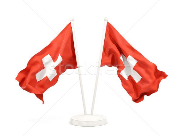 Dois bandeiras Suíça isolado branco Foto stock © MikhailMishchenko