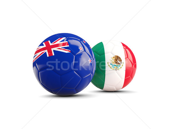 Two footballs with flags of New Zealand and Mexico isolated on w Stock photo © MikhailMishchenko