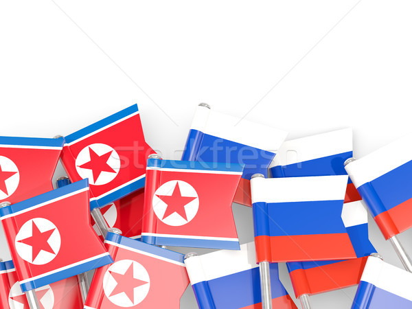 Flag pins of North Korea (DPRK) and Russia isolated on white Stock photo © MikhailMishchenko