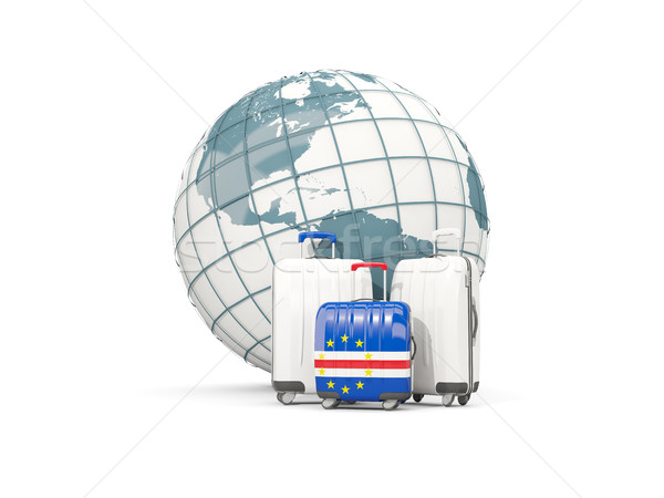 Luggage with flag of cape verde. Three bags in front of globe Stock photo © MikhailMishchenko