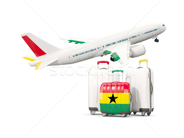 Luggage with flag of ghana. Three bags with airplane Stock photo © MikhailMishchenko