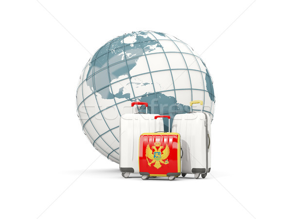 Luggage with flag of montenegro. Three bags in front of globe Stock photo © MikhailMishchenko