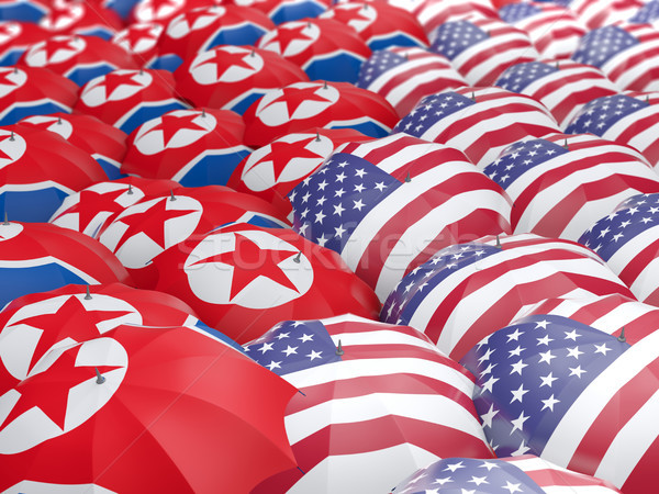 Flags of North Korea and US on umbrellas Stock photo © MikhailMishchenko
