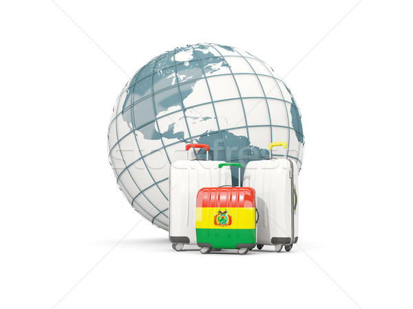 Luggage with flag of bolivia. Three bags in front of globe Stock photo © MikhailMishchenko