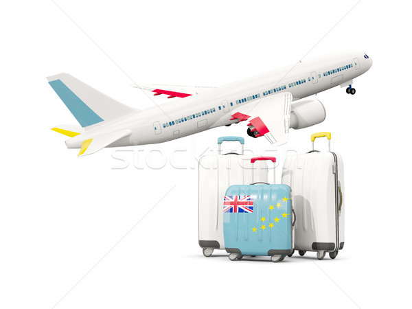 Luggage with flag of tuvalu. Three bags with airplane Stock photo © MikhailMishchenko