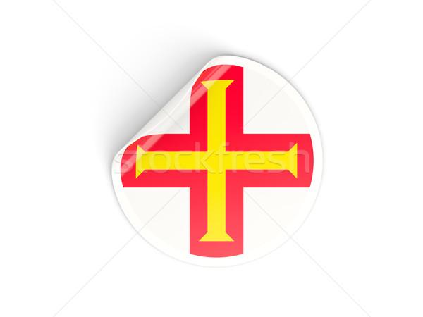 Round sticker with flag of guernsey Stock photo © MikhailMishchenko