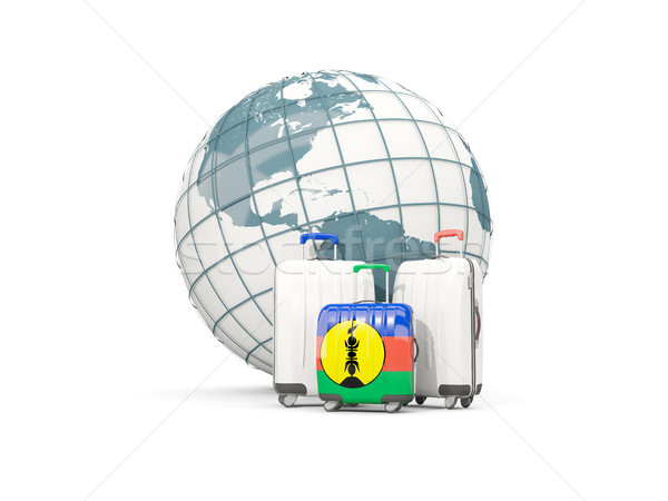 Luggage with flag of new caledonia. Three bags in front of globe Stock photo © MikhailMishchenko