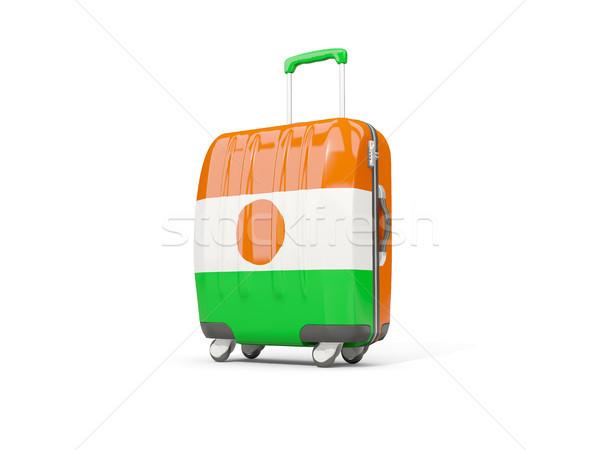 Luggage with flag of niger. Suitcase isolated on white Stock photo © MikhailMishchenko