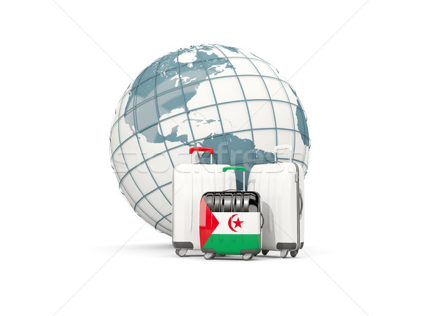 Luggage with flag of western sahara. Three bags in front of glob Stock photo © MikhailMishchenko