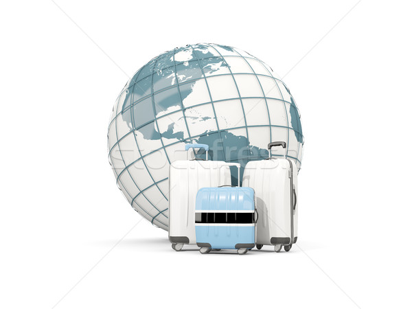 Stock photo: Luggage with flag of botswana. Three bags in front of globe