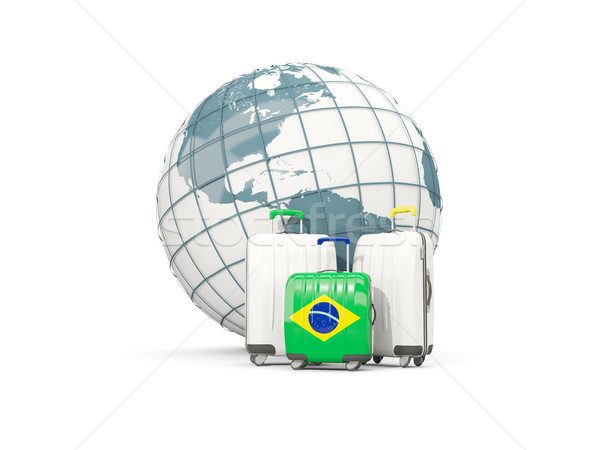Luggage with flag of brazil. Three bags in front of globe Stock photo © MikhailMishchenko