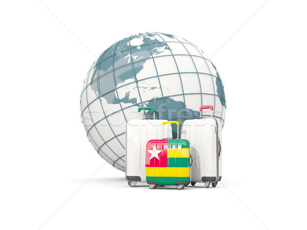 Luggage with flag of togo. Three bags in front of globe Stock photo © MikhailMishchenko