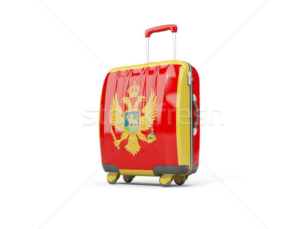Luggage with flag of montenegro. Suitcase isolated on white Stock photo © MikhailMishchenko