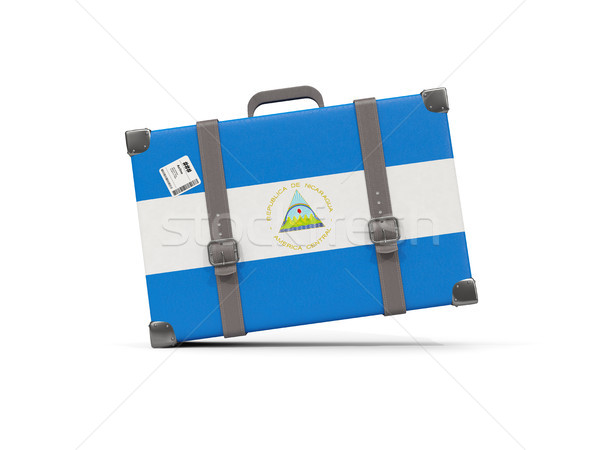 Luggage with flag of nicaragua. Suitcase isolated on white Stock photo © MikhailMishchenko