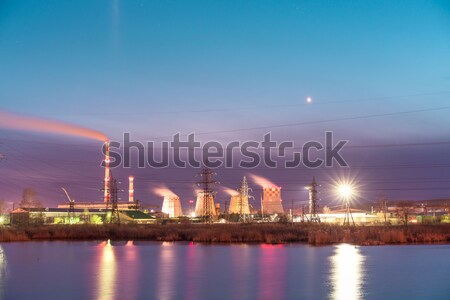Stock photo: Thermal power plant reflecting in the lake