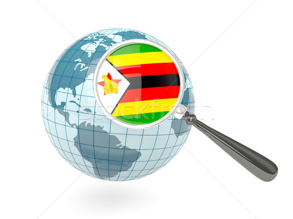 Magnified flag of zimbabwe with blue globe Stock photo © MikhailMishchenko