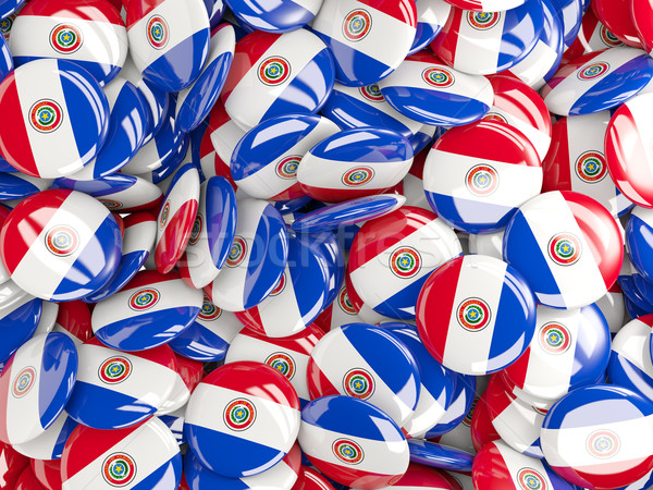 Background with round pins with flag of paraguay Stock photo © MikhailMishchenko