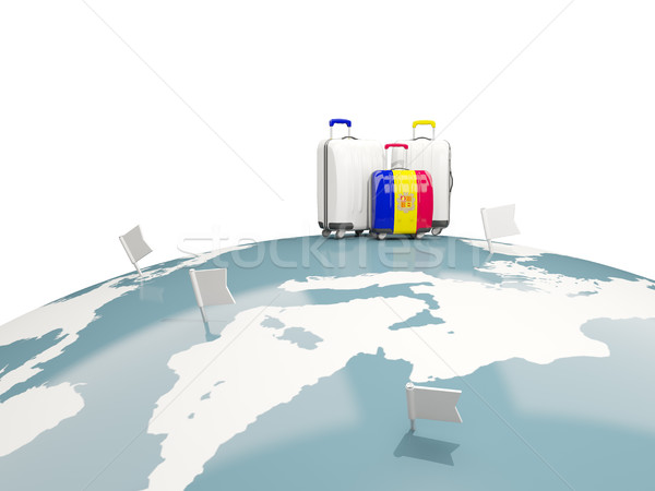 Luggage with flag of andorra. Three bags on top of globe Stock photo © MikhailMishchenko
