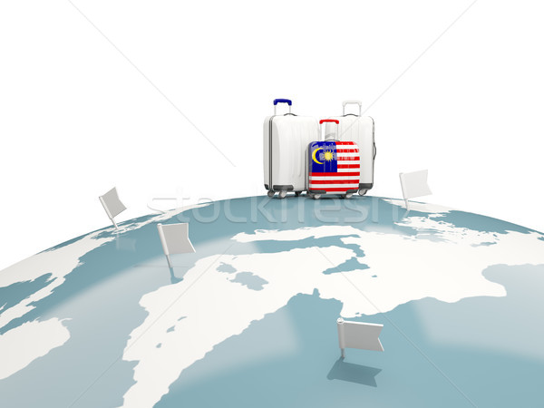 Stock photo: Luggage with flag of malaysia. Three bags on top of globe