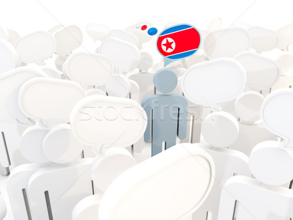 Man with flag of north korea in a crowd Stock photo © MikhailMishchenko