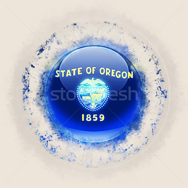 Stock photo: oregon state flag on a round grunge icon. United states local fl