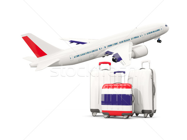 Luggage with flag of thailand. Three bags with airplane Stock photo © MikhailMishchenko