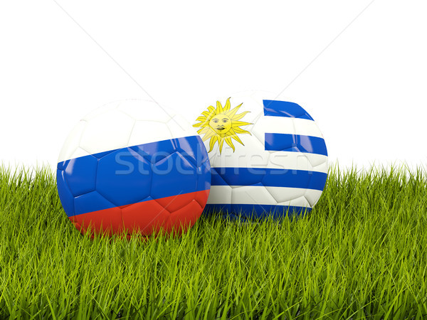Russia vs Uruguay. Soccer concept. Footballs with flags on green Stock photo © MikhailMishchenko