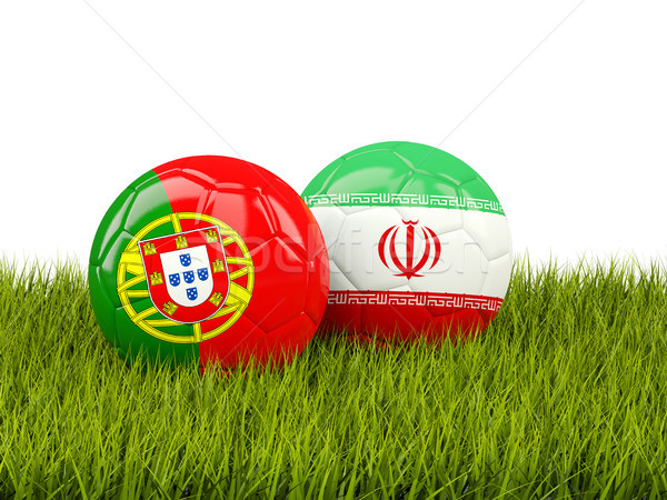 Stock photo: Portugal vs Iran. Soccer concept. Footballs with flags on green