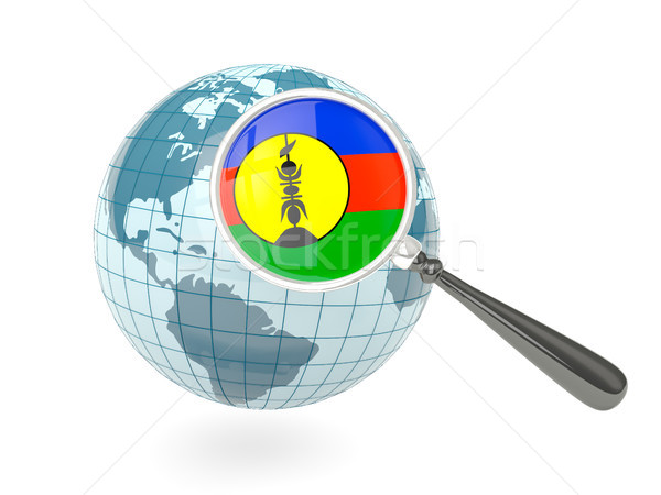 Magnified flag of new caledonia with blue globe Stock photo © MikhailMishchenko