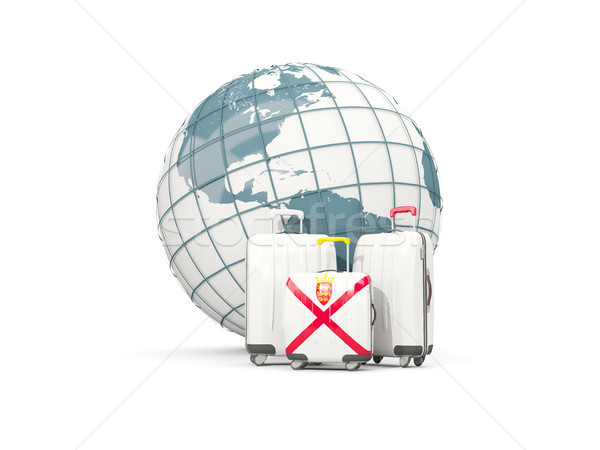 Luggage with flag of jersey. Three bags in front of globe Stock photo © MikhailMishchenko
