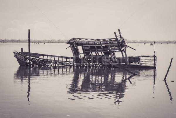 Skeleton of the sunken boat in a lake Stock photo © MikhailMishchenko