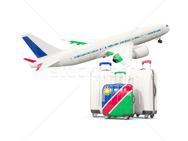 Luggage with flag of namibia. Three bags with airplane Stock photo © MikhailMishchenko