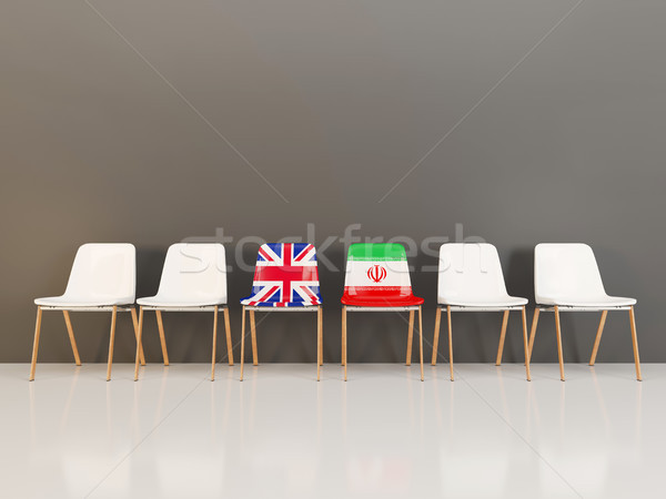 Stock photo: Chairs with flag of United Kingdom and iran