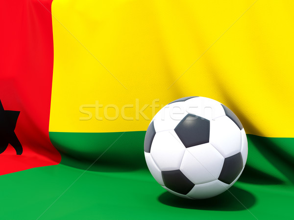 Flag of guinea bissau with football in front of it Stock photo © MikhailMishchenko