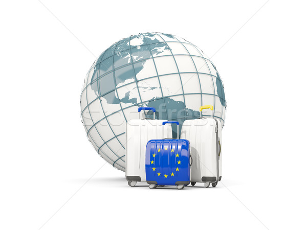 Luggage with flag of european union. Three bags in front of glob Stock photo © MikhailMishchenko