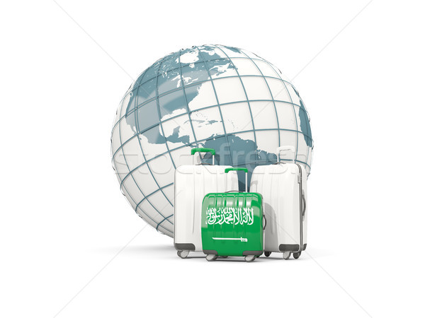 Luggage with flag of saudi arabia. Three bags in front of globe Stock photo © MikhailMishchenko