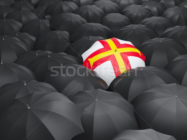 Umbrella with flag of guernsey Stock photo © MikhailMishchenko