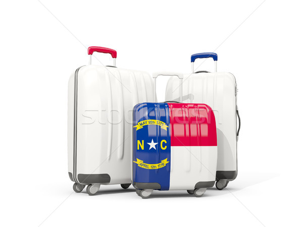 Luggage with flag of north carolina. Three bags with united stat Stock photo © MikhailMishchenko