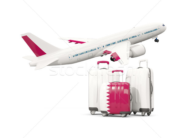 Luggage with flag of qatar. Three bags with airplane Stock photo © MikhailMishchenko