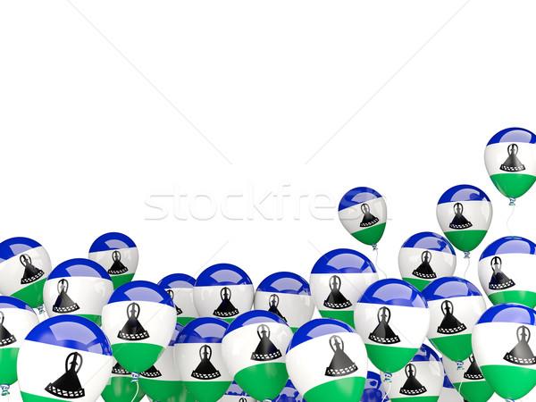 Battant ballons pavillon Lesotho isolé blanche Photo stock © MikhailMishchenko