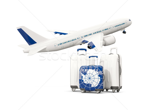 Luggage with flag of antarctica. Three bags with airplane Stock photo © MikhailMishchenko