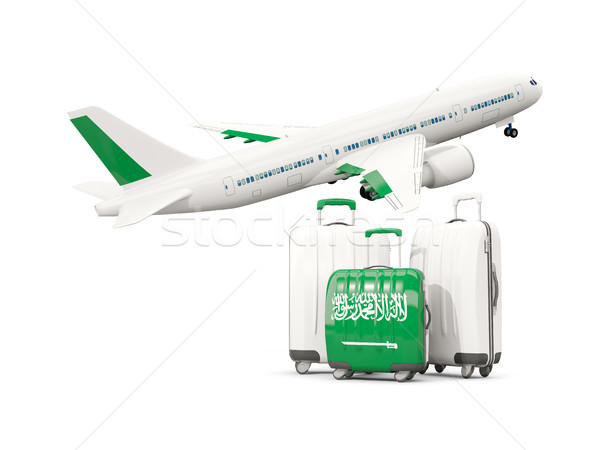 Luggage with flag of saudi arabia. Three bags with airplane Stock photo © MikhailMishchenko