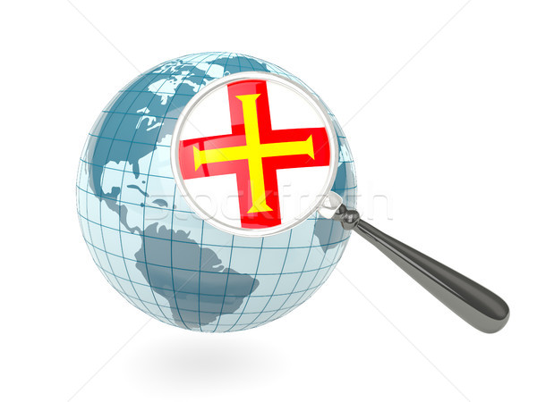 Magnified flag of guernsey with blue globe Stock photo © MikhailMishchenko